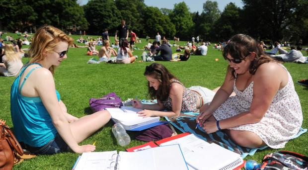 (L-R) Laura Beattie, Caitlin Buick and Rebecca Baker studying for exams in Botanic Gardens, Belfast yesterday