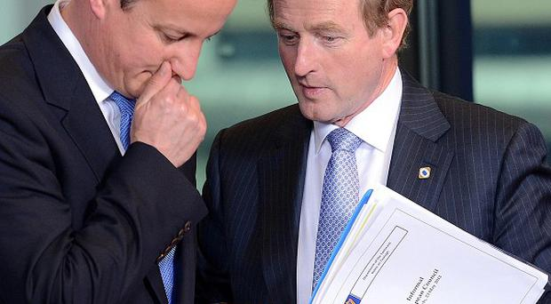 Taoiseach Enda Kenny with British Prime Minister David Cameron, left, during the EU summit in Brussels (AP)