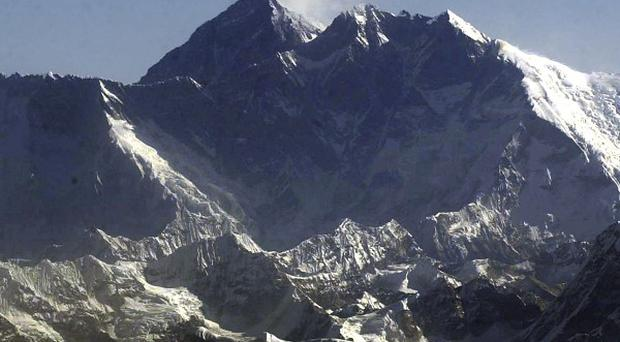 A climber has told how gave up the chance to reach the summit of Mount Everest to rescue a friend (AP)