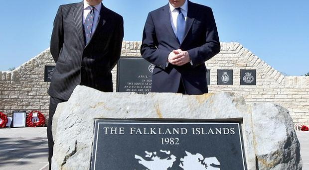 David Cameron is accompanied by NMA chief executive Charlie Bagot-Jewitt during a visit to the Falklands Memorial