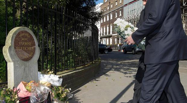 Libyan PM Abdurrahim El-Keib lays a wreath at the spot where policewoman Yvonne Fletcher was shot dead outside the country's London embassy in 1984