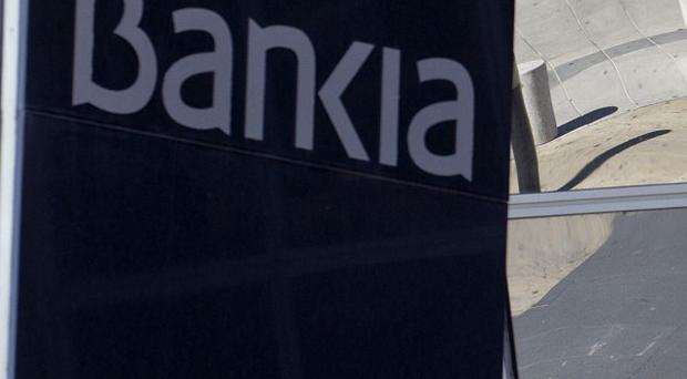 Shares in troubled Spanish lender Bankia have been suspended (AP)