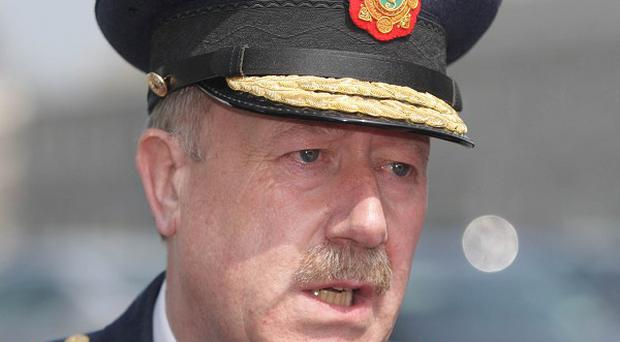 Garda Commissioner Martin Callinan has said the file of double killer John Gallagher is being revisited by officers