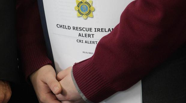 A student holds a copy of the Child Rescue Ireland Alert plan at the launch of the Alert system in Dublin
