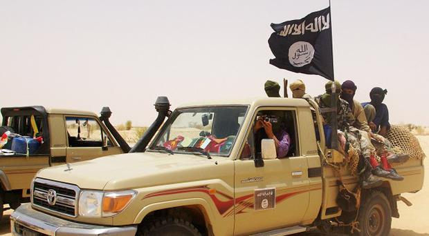 Fighters from Islamist group Ansar Dine in the desert outside Timbuktu, Mali (AP)
