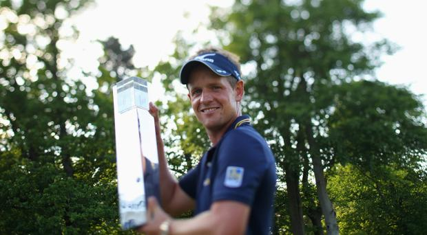 VIRGINIA WATER, ENGLAND - MAY 27: (EDITORS NOTE - THIS IMAGE WAS CREATED WITH A VARIABLE PLANED LENS) Luke Donald of England holds the trophy following his victory during the final round of the BMW PGA Championship on the West Course at Wentworth on May 27, 2012 in Virginia Water, England. (Photo by Warren Little/Getty Images)