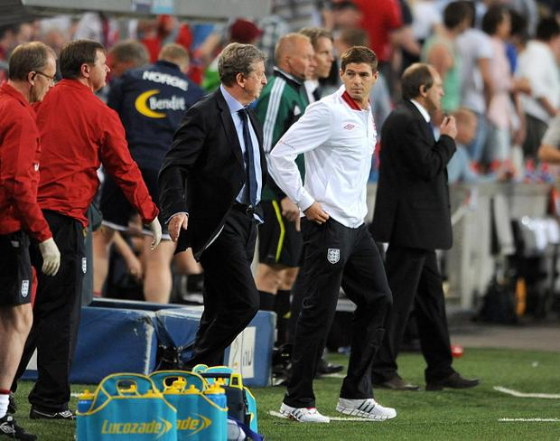England manager Roy Hodgson (left) alongside captain Steven Gerrard after the International Friendly at the Ullevaal Stadium, Oslo, Norway