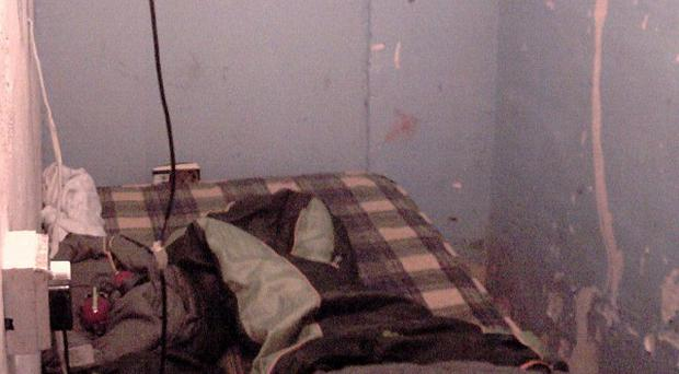 The filthy converted coal bunker where an 11-year-old boy was forced to live (PA/Lancashire Constabulary)