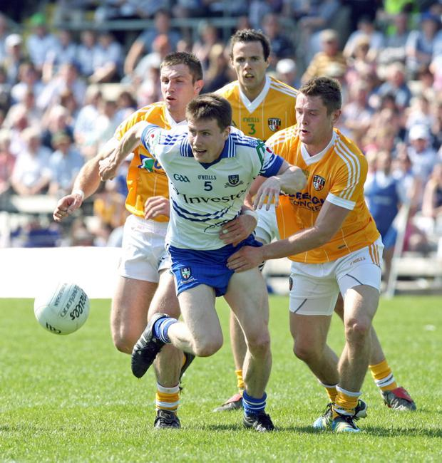 Karl O'Connell of Monaghan gets away from Tony Scullion, Richard Johnston and Mark Sweeney of Antrim