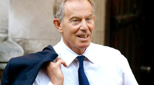 Former Prime Minister Tony Blair arrives at the High Court in London to evidence to Leveson Inquiry into press standards.