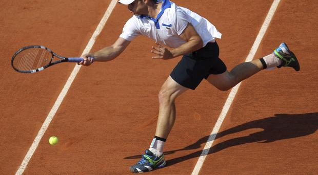 USA's Andy Roddick returns the ball to France's Nicolas Mahut during their first round match in the French Open tennis tournament at the Roland Garros stadium in Paris, Sunday, May, 27, 2012