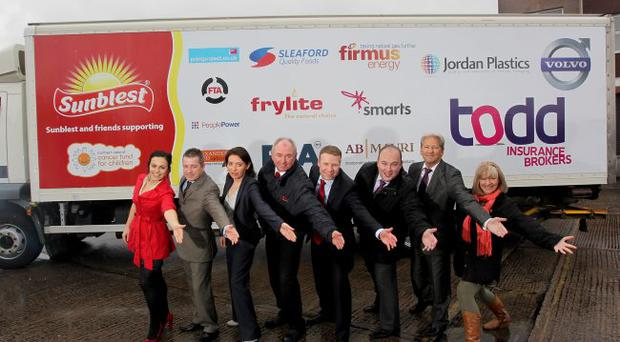 Angeline Sloan, Firmus Energy; Joe McGeown and Lisa Jordan, Jordan Plastics; George McCay, Frylite; Clive Kerrigan, Allied Bakeries, Matthew Todd, Todd Insurance Brokers; Ian Erwin, RLA; and Gillian Creevy, Chief Executive of NICFC are pictured at the launch of the Sunblest Lorry for Life.