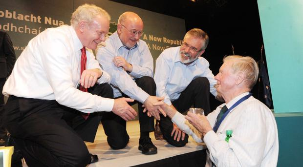 Sinn Fein Ard Fheis Day 2. (LtoR) Deputy first Minister of Northern Ireland Martin McGuinness, TD Caoimhghin O Caolain and President of Sinn Fein, Gerry Adams greet delegates after he delivered his Presidential address at the end of the Party's Ard Fheis at the INEC, Killarney.
