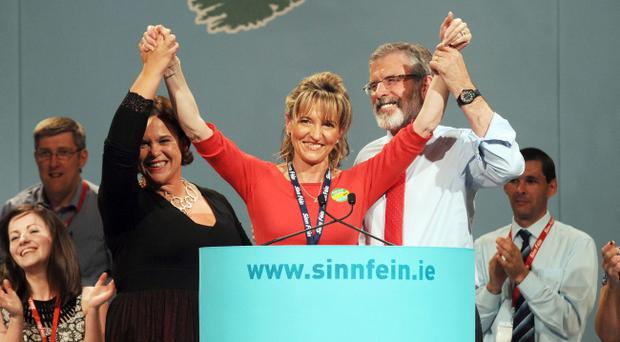 Sinn Fein Ard Fheis Day 2. President of Sinn Fein, Gerry Adams is joined on tage by Vice President Mary Lou McDonald (left) and newly appointed MEP to replace Bairbe de Brun, Martin Anderson, after he delivered his Presidential address at the end of the Party's Ard Fheis at the INEC, Killarney.
