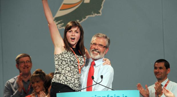 Sinn Fein Ard Fheis Day 2. President of Sinn Fein, Gerry Adams lifts Senator Kathryn Reilly up in celebration after he delivered his Presidential address at the end of the Party's Ard Fheis at the INEC, Killarney.