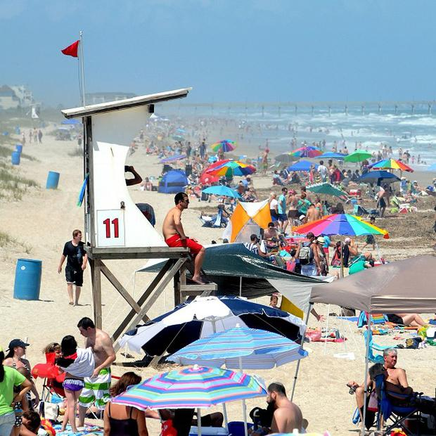 Red flags warning swimmers of dangerous conditions and rip currents due to Tropical Storm Beryl (AP/The Star-News, Jeff Janowski)