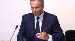 Tony Blair is grilled on his relationship with the press and Rupert Murdoch at an inquiry into media ethics in central London May 28