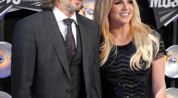 Jason Trawick has praised fiancee Britney Spears for a good start on US X Factor
