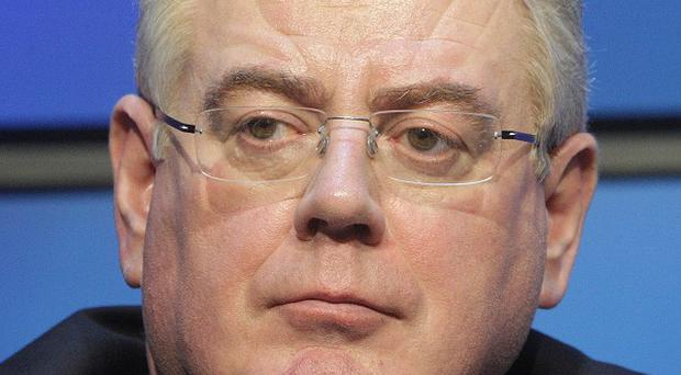 Eamon Gilmore has backed calls for an urgent meeting of the UN Security Council over the massacre in Houla