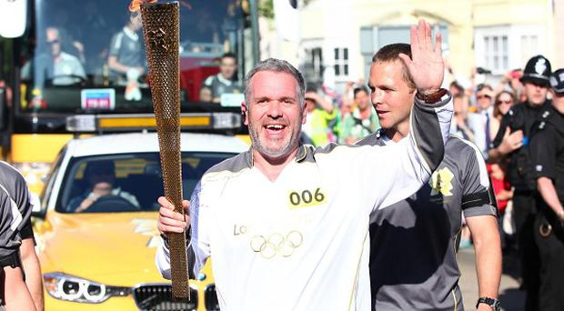 Chris Moyles surprised his radio colleagues when he became an Olympic torch-bearer live on his show