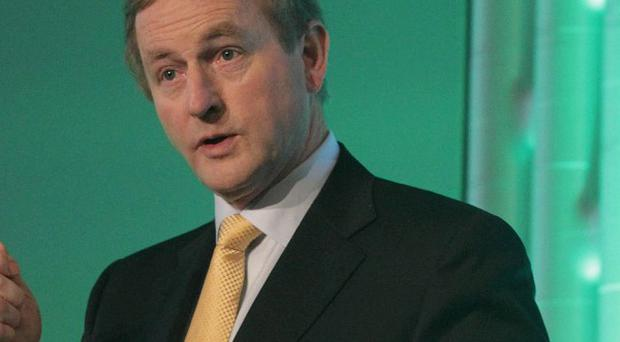 Enda Kenny is to announce 40 new jobs at an online company