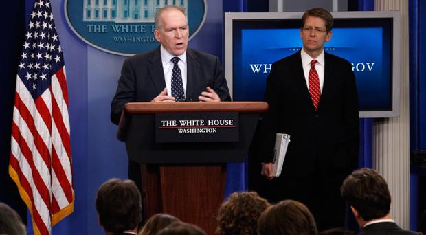 White House Deputy National Security Advisor for Homeland Security and Counterterrorism John Brennan (L) and White House Press Secretary Jay Carney