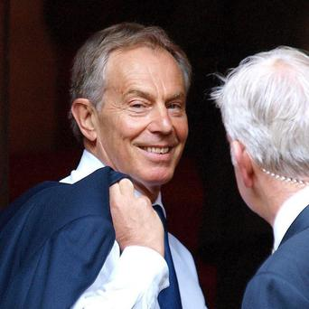 Former prime minister Tony Blair arrives at the High Court in London to give evidence to the Leveson Inquiry