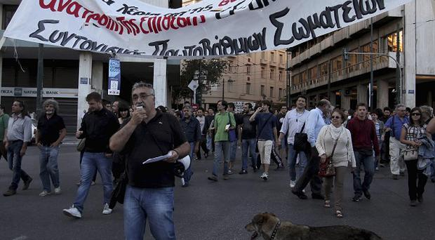 Protesters march through central Athens as Greece prepares for crucial June 17 elections (AP/Petros Giannakouris)