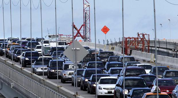 Traffic queues after one man was shot dead and another injured in Miami (AP)