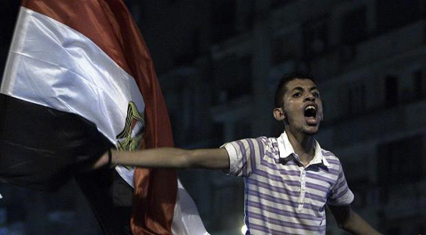 A youth protests over the outcome of the Egyptian presidential election in Cairo (AP)