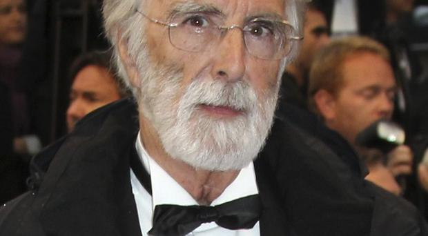 Director Michael Haneke has picked up the top prize at Cannes