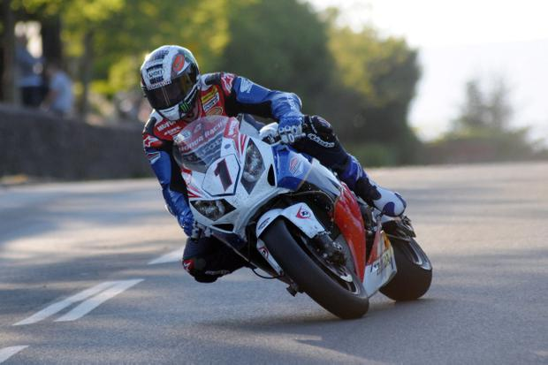 John McGuinness takes his time around this corner, but he was flying round the Isle of Man in the opening practice for the TT