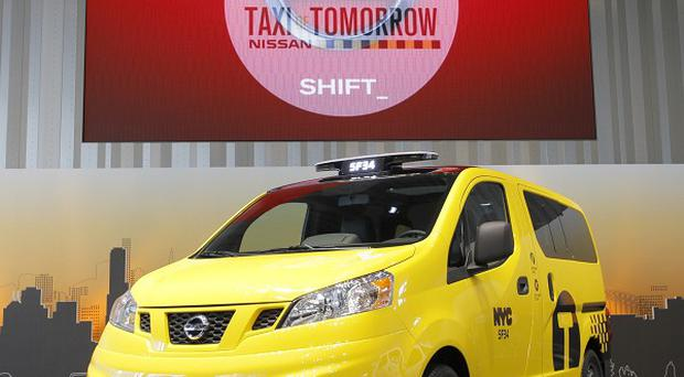 Nissan's NV200 vehicle painted in New York taxi livery is displayed at the car maker's headquarters in Yokohama, Japan (AP)