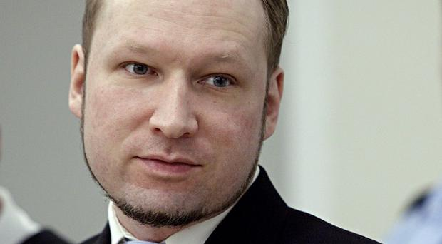Anders Breivik stands in the courtroom in Oslo for his murder trial (AP)