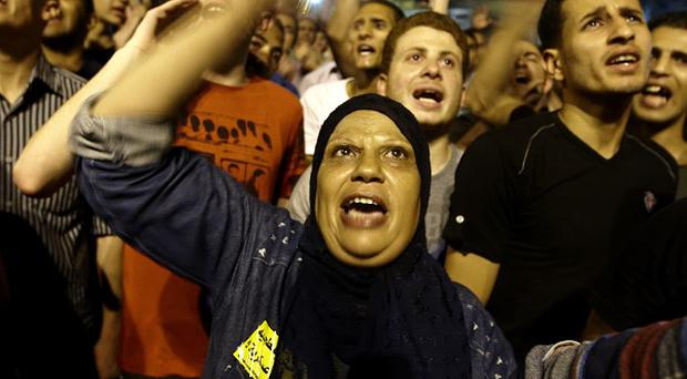 Protesters demonstrate over the outcome of the Egyptian presidential election in Tahrir Square, Cairo (AP)