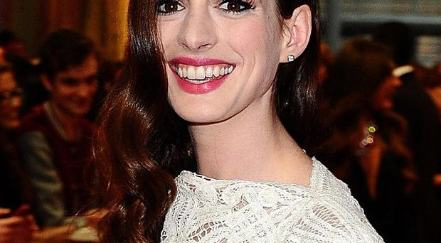 Anne Hathaway would have been happy to play any role in Chris Nolan's film