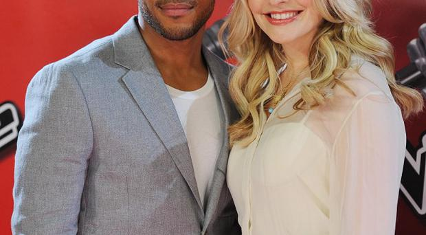 Holly Willoughby and Reggie Yates present the current series of The Voice