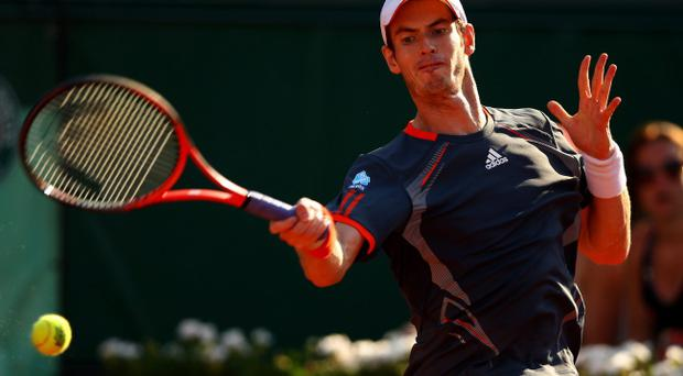 PARIS, FRANCE - MAY 29: Andy Murray of Great Britain plays a forehand in his men's singles match against Tatsuma Ito of Japan during day 3 of the French Open at Roland Garros on May 29, 2012 in Paris, France. (Photo by Clive Brunskill/Getty Images)