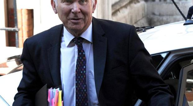 Business Secretary Vince Cable arrives to give evidence to the Leveson Inquiry into press standards at the High Court in London. May 30, 2012.