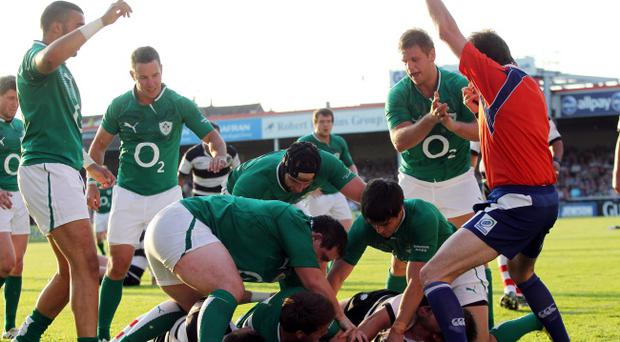 Ulster winger Craig Gilroy scores a try during Ireland's friendly encounter against the Barbarians