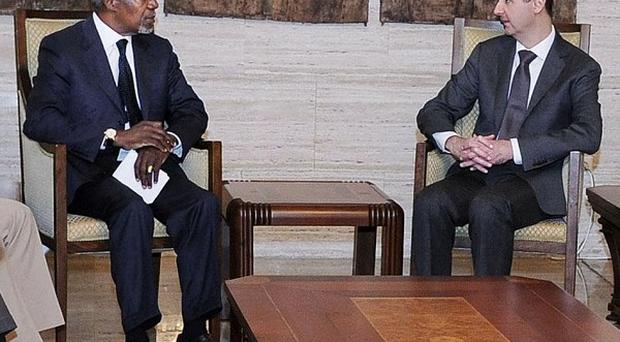 UN-Arab League joint special envoy for Syria Kofi Annan, left, listening to Syrian President Bashar Assad (AP)