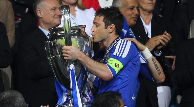 Frank Lampard kisses the Champions League trophy after Chelsea's victory in last month's final. Lampard's joy looks set to turn to disappointment as he appears unlikely to play a part for England at Euro 2012