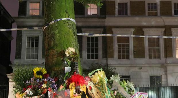 Floral tributes left outside the home of singer Amy Winehouse, at Camden Square in north London, which is now for sale