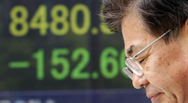 Japan's Nikkei 225 index shed 158 points to end the morning session at 8,474 (AP)