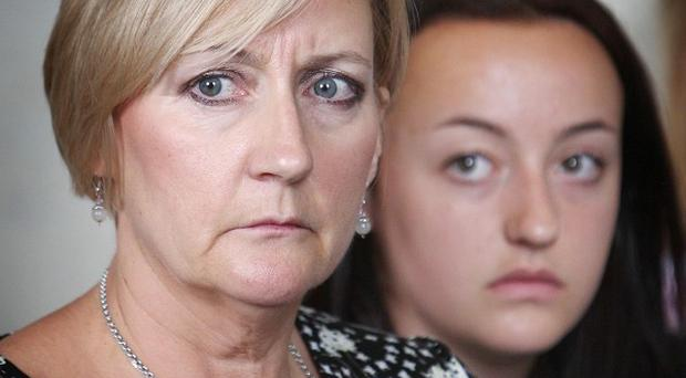 Julie and Sophie Reid, the wife and daughter of fireman Ian Reid, attend a press conference at Warwickshire Police headquarters