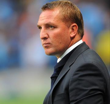 Brendan Rodgers has said he initially turned Liverpool down out of respect to Swansea City