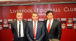 LIVERPOOL, UNITED KINGDOM - JUNE 01: Brendan Rodgers (C) is unveiled as the new Liverpool FC manager by Managing Director Ian Ayre (L) and Chaiman Tom Werner (R) at a press conference at Anfield on June 01, 2012 in Liverpool, England. (Photo by Clint Hughes/Getty Images)
