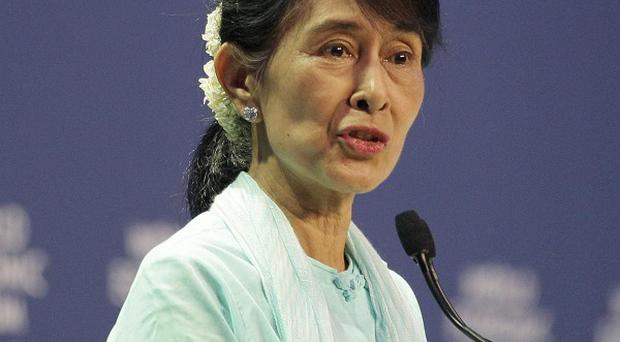 Burmese opposition leader Aung San Suu Kyi delivers a speech at the World Economic Forum on East Asia in Bangkok (AP)