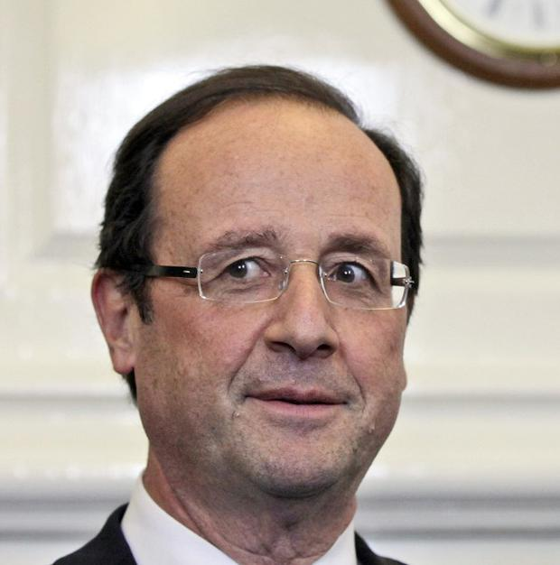 French president Francois Hollande is cutting more than 30 staff from his security team