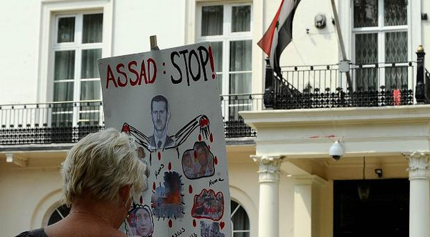 A protester demonstrates outside the Syrian Embassy in central London